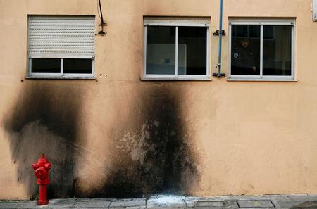 Damage caused by molotov cocktails is seen on the police station building at the Bela Vista neighborhood in Setubal, Portugal January 22, 2019. REUTERS/Rafael Marchante