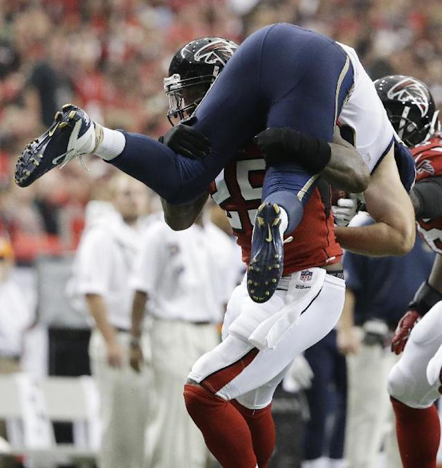 Atlanta Falcons strong safety William Moore (25) tackles St. Louis Rams tight end Mike McNeill (82) during the first half of an NFL football game, Sunday, Sept. 15, 2013, in Atlanta. (AP Photo/David Goldman)