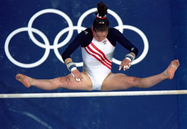 19 Sep 2000: Elise Ray of the United States swings over the uneven bars during the Women's Gymnastics at the Sydney Superdome in the 2000 Olympics in Sydney, Australia.Mandatory Credit: Al Bello /Getty Images