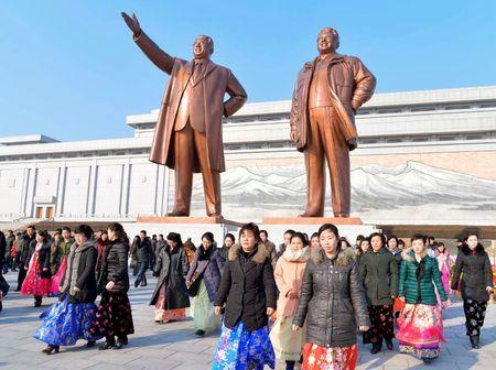 People visit the statues of North Korea's founder Kim Il-Sung (L) and his son and late leader Kim Jong-Il in Pyongyang, North Korea in this photo released by Kyodo February 16, 2018, to mark the 76th birthday of late North Korean leader Kim Jong-Il.   Mandatory credit Kyodo/via REUTERS