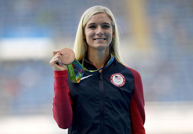 Emma Coburn poses with the bronze medal for the women's 3,000-meter steeplechase. (Shaun Botterill/Getty Images)
