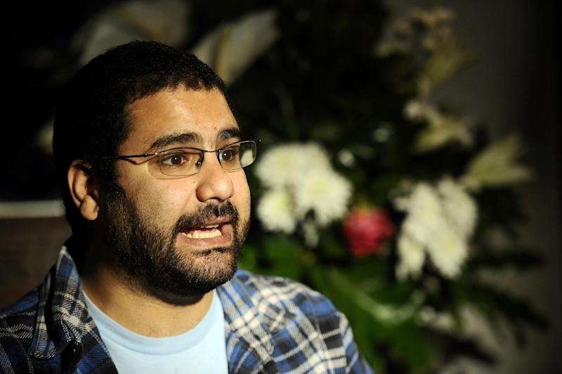 Egyptian blogger and activist Alaa Abdel Fattah speaks during a TV interview at his house in Cairo on December 26, 2011 (AFP Photo/Filippo Monteforte)
