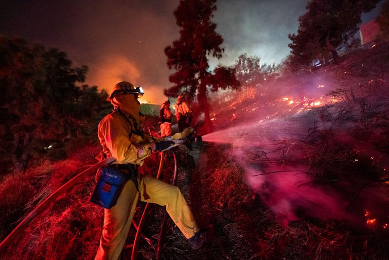 Firefighters work near Getty Center in Los Angeles Oct. 28, 2019. Thousands of residents were forced to evacuate their homes after a fast-moving wildfire erupted early Monday morning near the famous Getty Center.   Xinhua News Agency—Xinhua News Agency/Getty Images