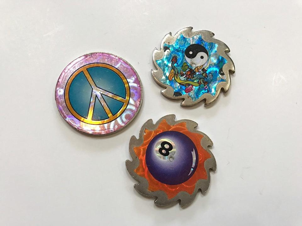 <p>Throw it way back to recess Pog games with these <span>1990s Pog Slammers</span> ($31 for three) from the early '90s. </p>