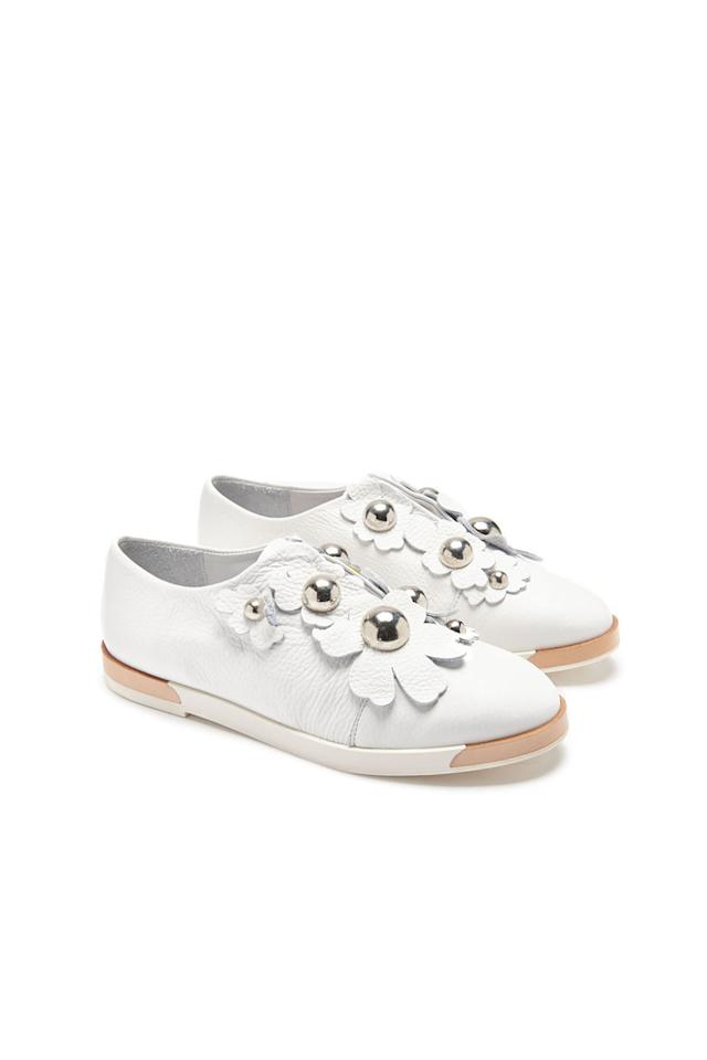 "<p>The latest in beautiful white sneakers (which are definitely worth the perpetual dirt dilemma) are topped with summery white florals. </p><p><strong>Blanche White Slip-Ons, $295; <a rel=""nofollow"" href=""https://usa.miista.com/collections/flats/products/blanche-white-flats"">miista.com</a>.</strong></p>"