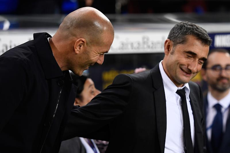 "Real Madrid's French coach Zinedine Zidane (L) and Barcelona's Spanish coach Ernesto Valverde shake hands prior to the ""El Clasico"" Spanish League football match between Barcelona FC and Real Madrid CF at the Camp Nou Stadium in Barcelona on December 18, 2019, (Photo by Josep LAGO / AFP) (Photo by JOSEP LAGO/AFP via Getty Images)"