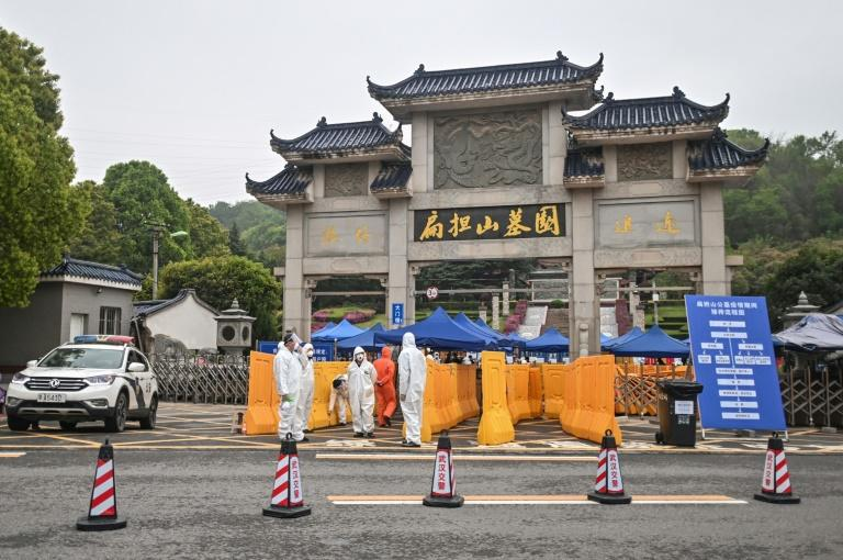 As the lockdown in China's virus epicentre Wuhan was eased, for many the first outdoor act in more than two months was to bury loved ones
