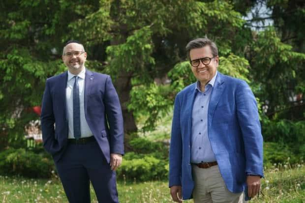 Lionel Perez, left, announced Wednesday he is running for borough mayor under the leadership of Denis Coderre, right. (Ivanoh Demers/Radio-Canada - image credit)