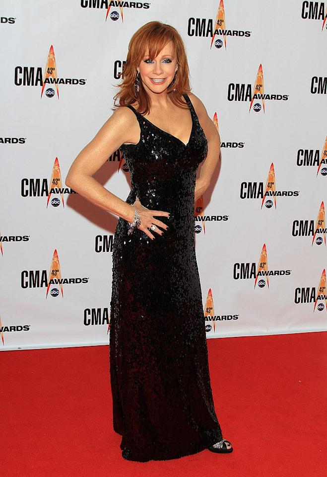 """Reba McEntire  Grade: A-  The fiery redhead set hearts afire in a sequined stunner. Taylor Hill/<a href=""""http://www.wireimage.com"""" target=""""new"""">WireImage.com</a> - November 11, 2009"""