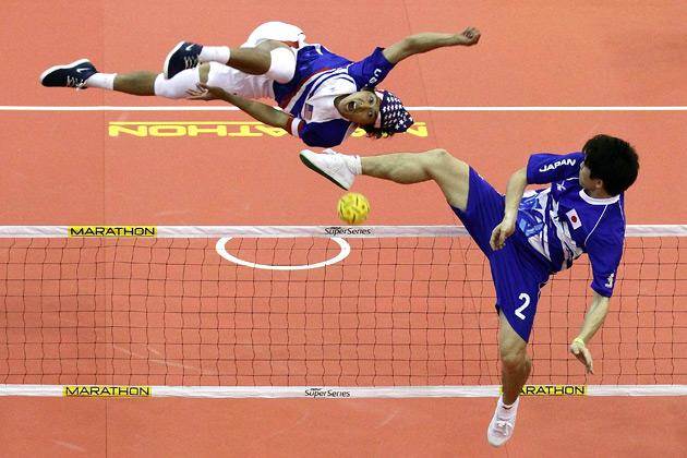Tony Ontam (L) of USA returns a strike to Hayashi Masanori of Japan on day one of the ISTAF Super Series at ITE Campus on May 3, 2012 in Singapore.  (Photo by Suhaimi Abdullah/Getty Images for UFA Sports)