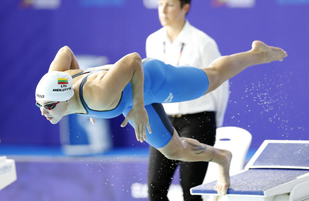 FILE - In this Saturday, Aug. 4, 2018 file photo, Ruta Meilutyte of Lithuania dives for her 100 meters breaststroke women's semifinal at the European Swimming Championships in Glasgow, Scotland. Former Olympic swimming champion Ruta Meilutyte retired from the sport Wednesday May 22, 2019, after missing three doping tests. (AP Photo/Darko Bandic, File)