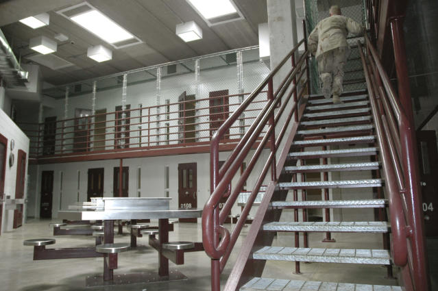GUANTANAMO BAY NAVAL BASE, CUBA - JULY 23: In this image reviewed by the U.S. Military, a guard walks up a stairway inside a high-security portion of the detention center July 23, 2008 at Guantanamo Bay U.S. Naval Base, in Cuba. The military base is providing the location for the trial of Salim Hamdan, the former driver for Osama bin Laden, who is charged with conspiracy and aiding terrorism and is the first prisoner to face a U.S. war-crimes trial since World War II. (Randall Mikkelsen-Pool/Getty Images)