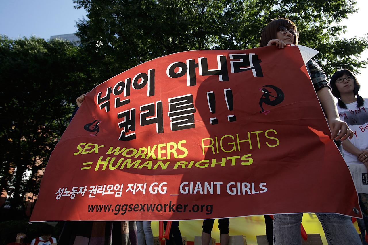 SEOUL, SOUTH KOREA - SEPTEMBER 22:  South Korean civic group members participate in a rally on September 22, 2005 in Seoul, South Korea. Prostitutes rallied against government law aimed at the sex industry. The government began enforcing new laws seven year ago to target human traffickers, pimps and prostitutes. Prostitutes will rallied against government law aimed at the sex industry. Nearly seven years after tough laws began driving thousands of South Korean prostitutes out of business, sex workers of the red-light district are fighting back, spurred by what they say is an unprecedented campaign of police harassment.  (Photo by Chung Sung-Jun/Getty Images)
