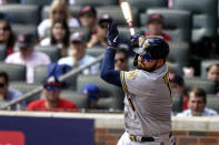 Milwaukee Brewers' Rowdy Tellez (11) strikes out against Atlanta Braves starting pitcher Ian Anderson during the fourth inning of Game 3 of a baseball National League Division Series, Monday, Oct. 11, 2021, in Atlanta. (AP Photo/Brynn Anderson)