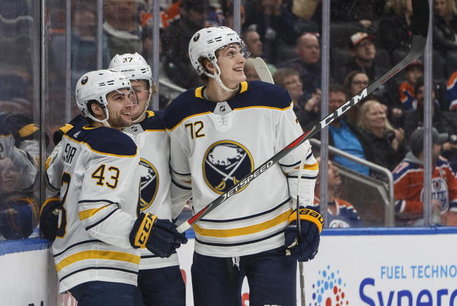 Buffalo Sabres' Conor Sheary (43), Casey Mittelstadt (37) and Tage Thompson (72) celebrate a goal against the Edmonton Oilers during first period NHL hockey action in Edmonton, Alberta, on Monday, Jan. 14, 2019. (Jason Franson/The Canadian Press via AP)