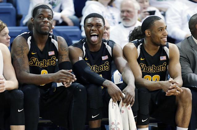 Wichita State forward Cleanthony Early, center, reacts on the bench with teammates Chadrack Lufile, left, and Tekele Cotton, right, during the second half of an NCAA college basketball game against Drake, Saturday, Jan. 25, 2014, in Des Moines, Iowa. Early scored 19 points as Wichita State won 78-61. (AP Photo/Charlie Neibergall)