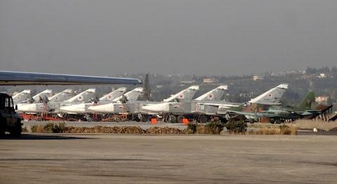 A general view shows Russian fighter jets on the tarmac at the Russian Hmeimim military base in Latakia province, in the northwest of Syria - Credit: AFP