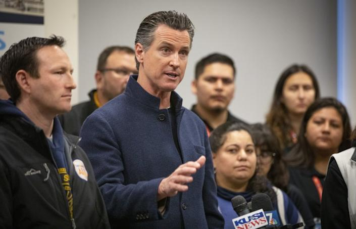 California Governor Gavin Newsom (D), center, holds a new conference at PATH San Diego's Connections Housing facility in downtown San Diego after the annual point-in-time homeless count, January 23, 2020 in San Diego, California.