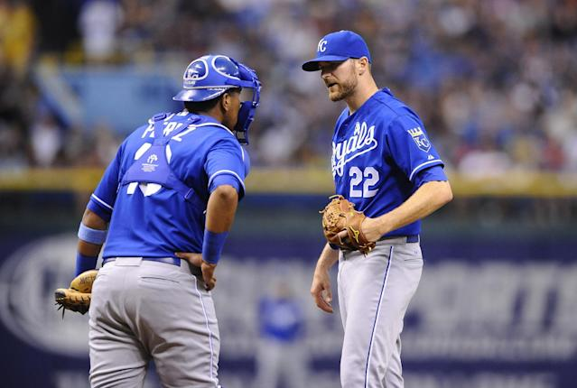 Kansas City Royals starting pitcher Wade Davis, right, and catcher Salvador Perez have a conversation on the mound after Davis walked Tampa Bay Rays left fielder Kelly Johnson to load the bases during the first inning of a baseball game Sunday, June 16, 2013, in St. Petersburg, Fla. (AP Photo/Brian Blanco)