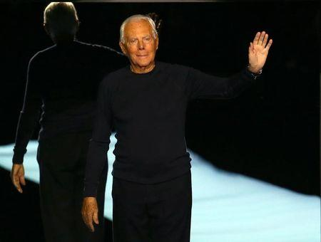 Italian designer Giorgio Armani acknowledges the applause at the end of his Autumn/Winter 2017 women collection during Milan Fashion Week, in Milan