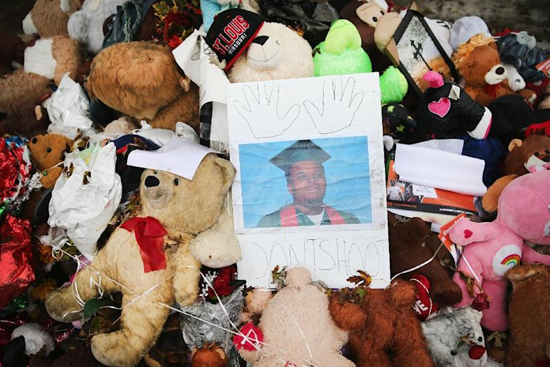 A makeshift memorial sits near the spot where 18-year-old Michael Brown was shot and killed by a police officer on October 10, 2014 in Ferguson, Missouri