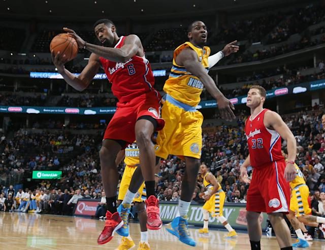 Los Angeles Clippers center DeAndre Jordan, left, pulls down rebound in front of Denver Nuggets forward J.J. Hickson, center, as Clippers forward Blake Griffin looks on in the third quarter of the Nuggets' 116-115 victory in an NBA basketball game in Denver, Monday, Feb. 3, 2014. (AP Photo/David Zalubowski)