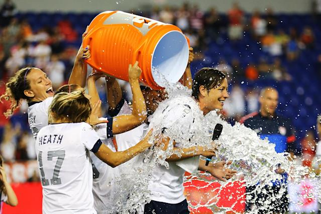 HARRISON, NJ - JUNE 20: Abby Wambach #20 of the USA gets a Gatorade bath by her teamates after a 5-0 win against Korea Republic after Wambach broke Mia Hamm's alltime International goal scoring record with 159 at Red Bull Arena on June 20, 2013 in Harrison, New Jersey. (Photo by Al Bello/Getty Images)