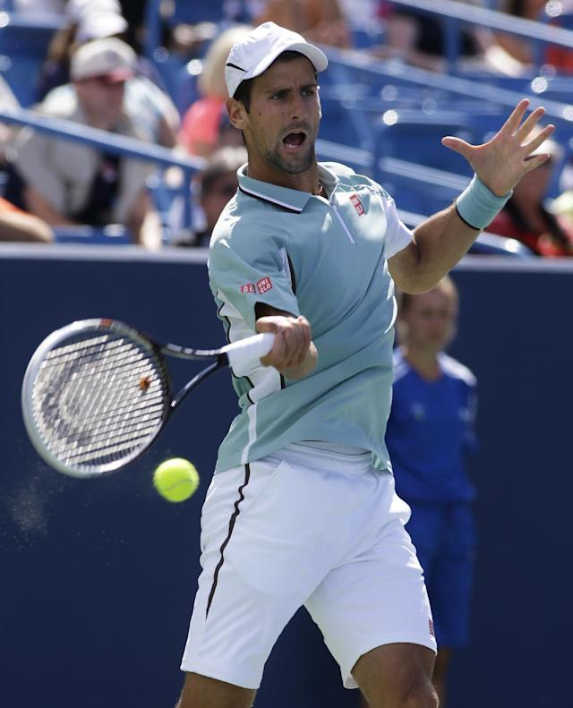 Novak Djokovic, from Serbia, hits a forehand against Juan Monaco, from Argentina, during a match at the Western & Southern Open tennis tournament, Wednesday, Aug. 14, 2013, in Mason, Ohio. (AP Photo/Al Behrman)
