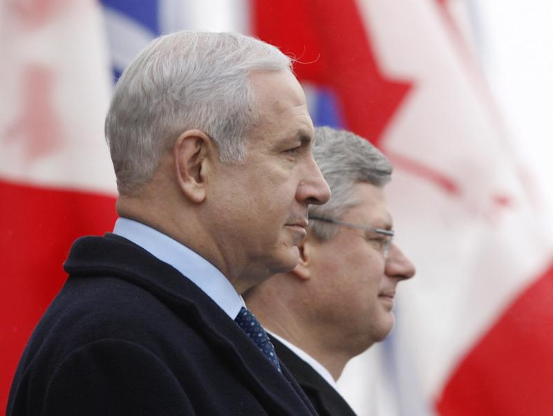 Canadian Prime Minister Stephen Harper and Israeli Prime Minister Benjamin Netanyahu arrive on Parliament Hill   in Ottawa Friday March 1, 2012.   (AP Photo/The Canadian Press, Adrian Wyld)