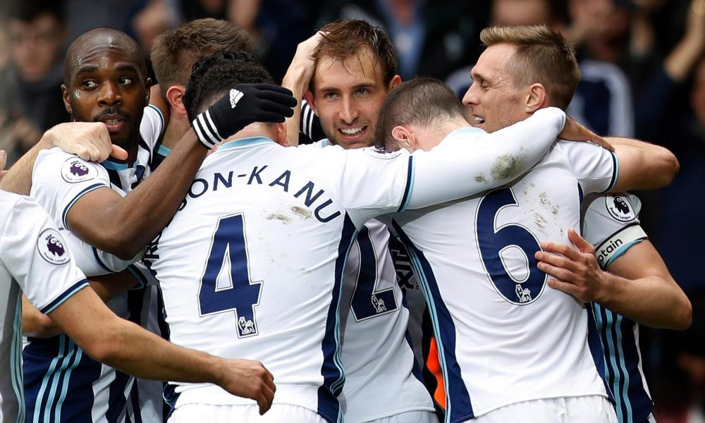 Craig Dawson, centre, celebrates scoring West Brom's third goal against Arsenal with his teammates.
