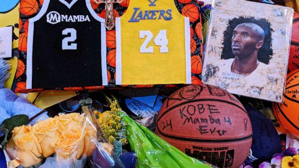 PHOTO: Memorabilia for NBA star Kobe Bryant placed at a memorial for Bryant by fans paying their respect near Staples Center in Los Angeles, Feb. 2, 2020. (Damian Dovarganes/AP)