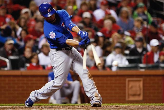 Chicago Cubs' Welington Castillo breaks his bat as he hits a single during the sixth inning of a baseball game against the St. Louis Cardinals on Tuesday, May 13, 2014, in St. Louis. (AP Photo/Scott Kane)