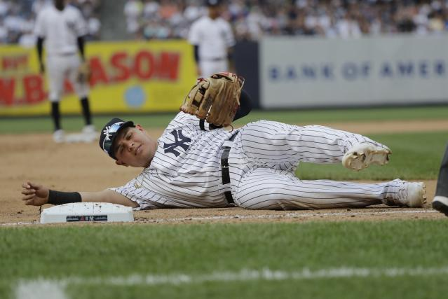 New York Yankees third baseman Gio Urshela reacts after getting hurt during the fifth inning of a baseball game against the Arizona Diamondbacks Wednesday, July 31, 2019, in New York. (AP Photo/Frank Franklin II)
