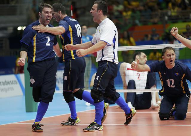 2016 Rio Paralympics - Sitting Volleyball - Final - Men's Gold Medal Match - Riocentro Pavilion 6 - Rio de Janeiro, Brazil - 18/09/2016. Adnan Manko, Safet Alibasic and Adnan Kesmer (BIH) of Bosnia and Herzegovina celebrate. REUTERS/Ueslei Marcelino FOR EDITORIAL USE ONLY. NOT FOR SALE FOR MARKETING OR ADVERTISING CAMPAIGNS.