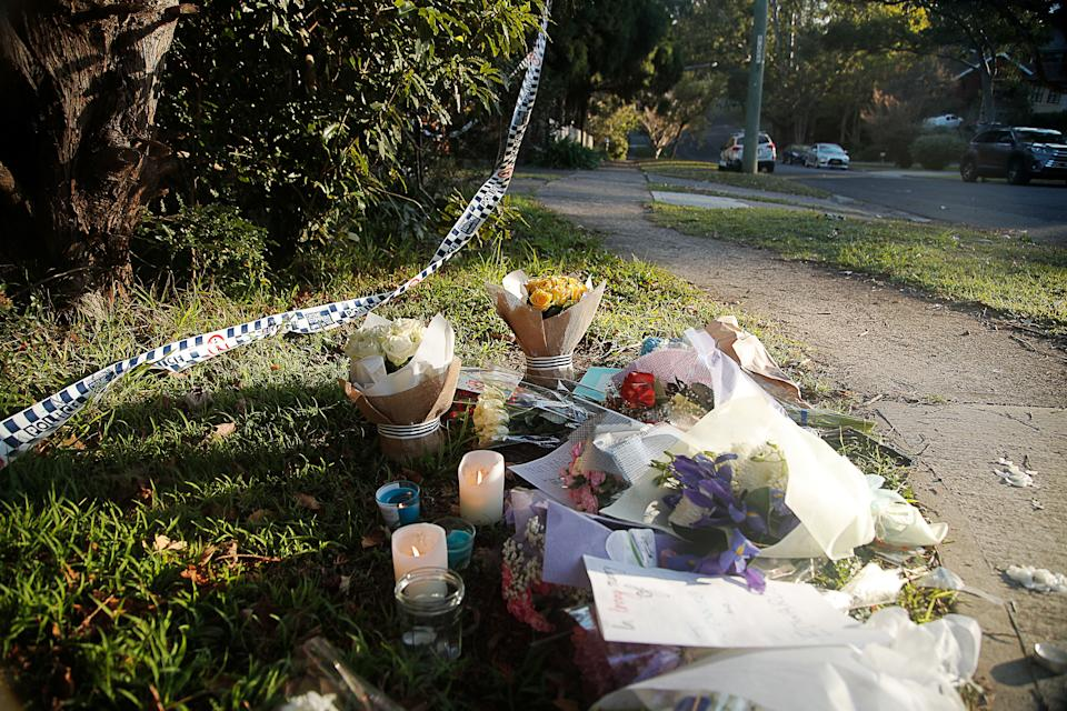 Flowers and tributes are seen at a property in West Pennant Hills, Sydney, Saturday, July 7, 2018. A father killed his 15-year-old son and 13-year-old daughter at the property on Thursday afternoon. On Friday the 68-year-old, John Edwards, was found dead in his own home in the nearby suburb of Normanhurst after taking his own life.