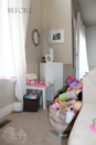 """<p>Without any containers in sight, <a href=""""http://www.thriftyandchic.com/2015/03/hidden-play-area-in-plain-sight.html"""" rel=""""nofollow noopener"""" target=""""_blank"""" data-ylk=""""slk:toys and games"""" class=""""link rapid-noclick-resp"""">toys and games</a> end up strewn across the ground, and the brightly colored accents really don't blend in with the decor.</p>"""