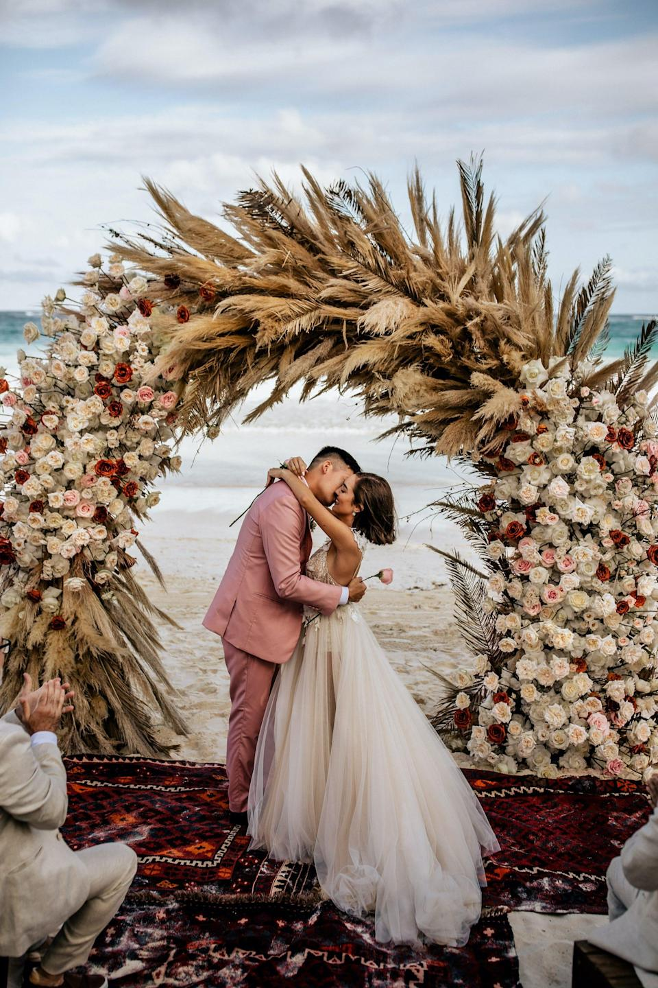 The Baks kiss during their wedding ceremony