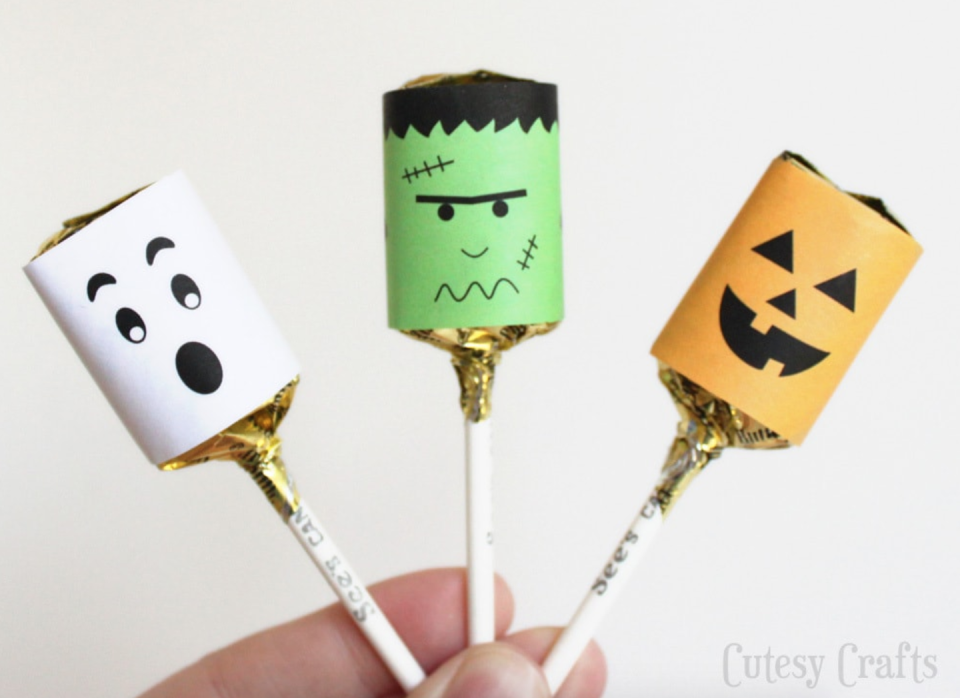 """<p>Kids will have so much fun decorating their favorite lollipops with these cute characters. Once they are all done, let them pass 'em out to all the kids in their class (if it's safe to do so). </p><p><a href=""""https://cutesycrafts.com/2013/09/halloween-lollypop-printables.html"""" rel=""""nofollow noopener"""" target=""""_blank"""" data-ylk=""""slk:Get the printable at Cutesy Crafts »"""" class=""""link rapid-noclick-resp""""><em>Get the printable at Cutesy Crafts »</em> </a></p>"""