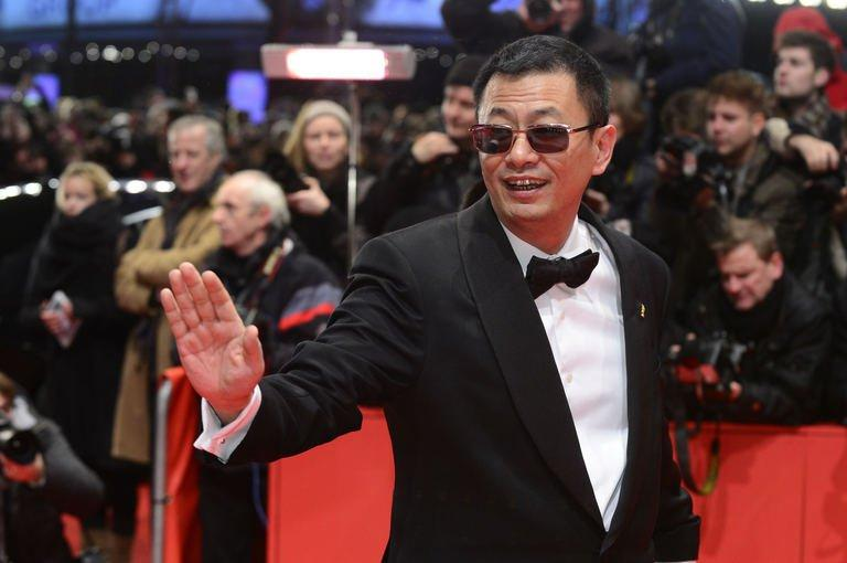 Chinese director Wong Kar Wai poses on the red carpet in Berlin on February 7, 2013