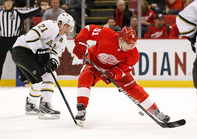 DETROIT, MI - FEBRUARY 14: Valtteri Filppula #51 of the Detroit Red Wings tries to control the puck in front of Loui Eriksson #21 of the Dallas Stars at Joe Louis Arena on February 14, 2012 in Detroit, Michigan. (Photo by Gregory Shamus/Getty Images)