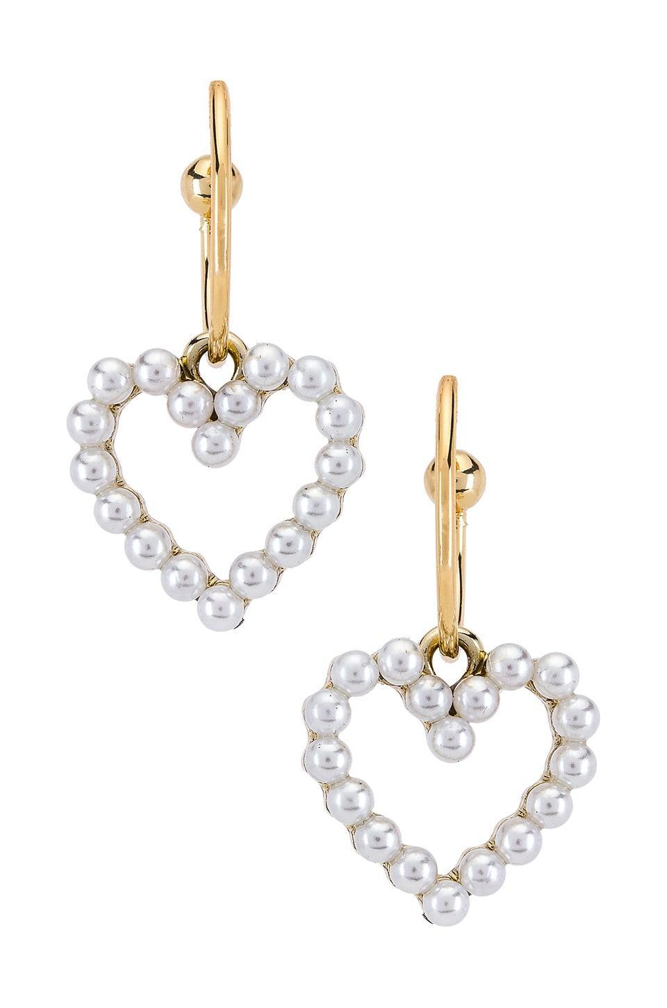 """<p><a href=""""https://www.popsugar.com/buy/Shashi-Heart-Pearl-Hoops-497266?p_name=Shashi%20Heart%20of%20Pearl%20Hoops&retailer=revolve.com&pid=497266&price=38&evar1=fab%3Aus&evar9=46708649&evar98=https%3A%2F%2Fwww.popsugar.com%2Ffashion%2Fphoto-gallery%2F46708649%2Fimage%2F46709060%2FShashi-Heart-Pearl-Hoops&list1=shopping%2Cjewelry%2Cunder%20%2450%2Caffordable%20shopping%2Cjewelry%20shopping&prop13=mobile&pdata=1"""" rel=""""nofollow noopener"""" class=""""link rapid-noclick-resp"""" target=""""_blank"""" data-ylk=""""slk:Shashi Heart of Pearl Hoops"""">Shashi Heart of Pearl Hoops</a> ($38)</p>"""