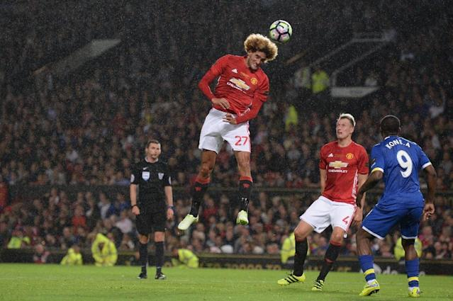 Manchester United manager Jose Mourinho had words of praise for Marouane Fellaini (C) who became a figure of derision under Mourinho's predecessors David Moyes and Louis van Gaal (AFP Photo/Oli Scarff )