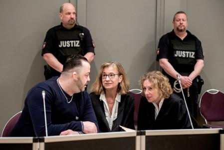 FILE PHOTO: Niels Hoegel, accused of murdering 100 patients at the clinics in Delmenhorst and Oldenburg, speaks to his lawyer Ulrike Baumann during his trial in Oldenburg