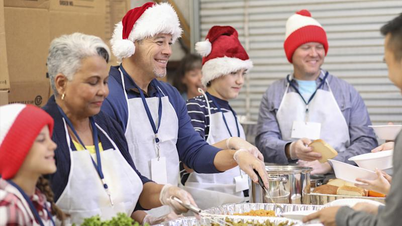 volunteers serving Christmas dinner at a shelter