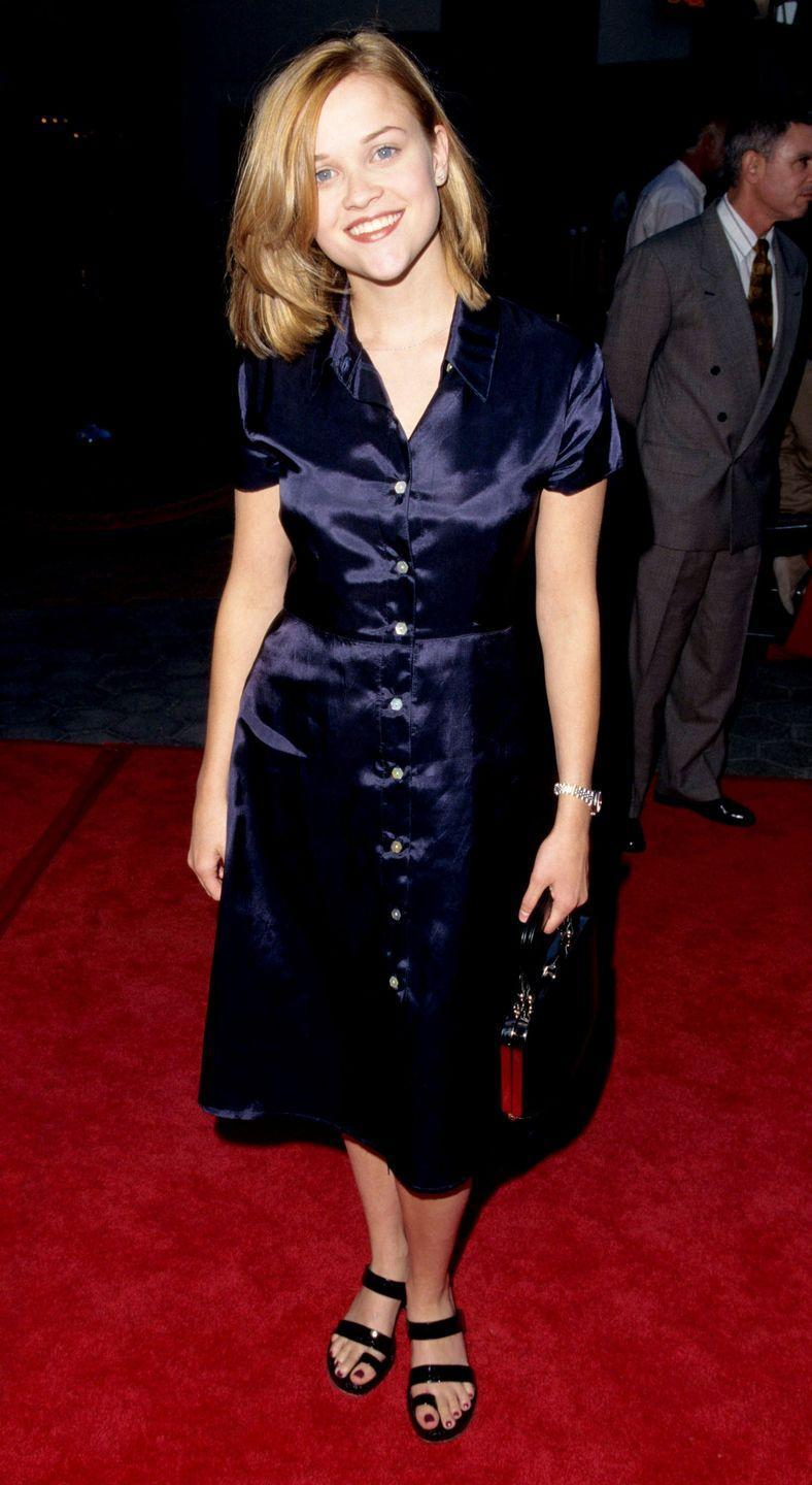 <p>A satin dress felt casual and effortless, a style we'd still wear today. </p>