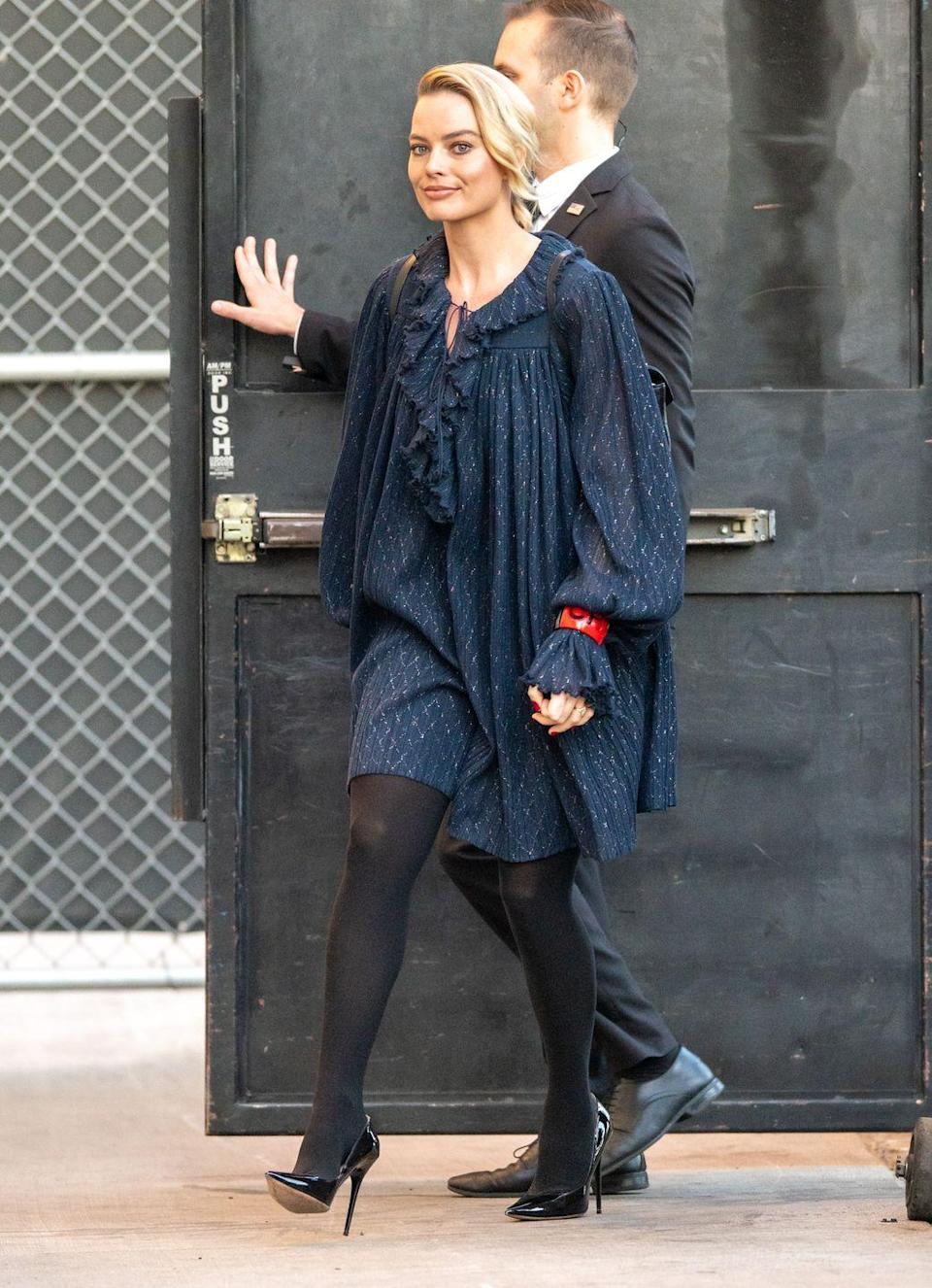 <p>Heading to the Tonight Show With Jimmy Fallon, Robbie looked super chic in a navy smock dress, paired with tights and black heels.</p>