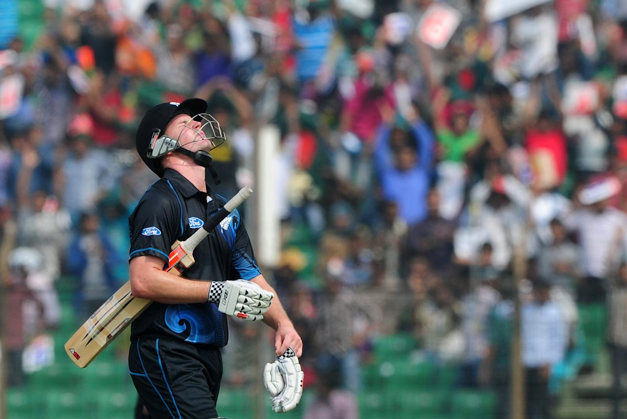New Zealand batsman Colin Munro reacts on losing his wicket to Bangladesh bowler Mohammad Mahmudullah during the third One-Day International (ODI) cricket match between Bangladesh and New Zealand at Khan Jahan Ali Stadium in Fatullah, on the outskirts of Dhaka on November 3, 2013.   AFP PHOTO/ Munir uz ZAMAN        (Photo credit should read MUNIR UZ ZAMAN/AFP/Getty Images)