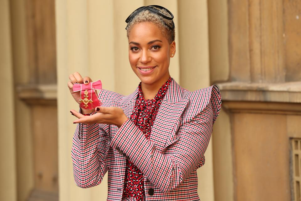 LONDON, UNITED KINGDOM - OCTOBER 10: Actress Cush Jumbo holding her OBE during an investiture ceremony at Buckingham Palace, on October 10, 2019 in London, England. (Photo by Jonathan Brady - WPA Pool/Getty Images)
