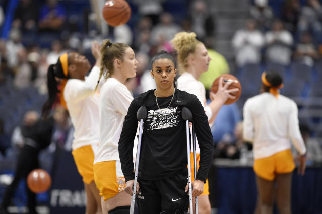Connecticut's Evina Westbrook, a transfer from Tennessee watches her team warm up as Tennessee players warm up behind her before an NCAA college basketball game between the teams, Thursday, Jan. 23, 2020, in Hartford, Conn. (AP Photo/Jessica Hill)