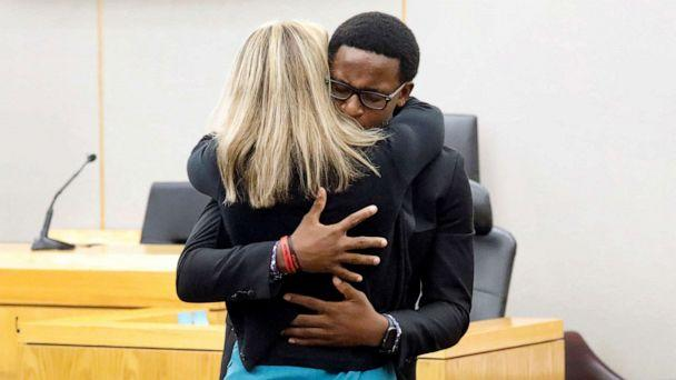 PHOTO: Botham Jean's younger brother Brandt Jean hugs former Dallas police officer Amber Guyger following her 10-year prison sentence for murder at the Frank Crowley Courts Building in Dallas, Texas, Oct. 2, 2019. (Tom Fox/Reuters, FILE)
